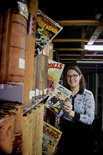 Hailey Austin, BA'16 holding comic books