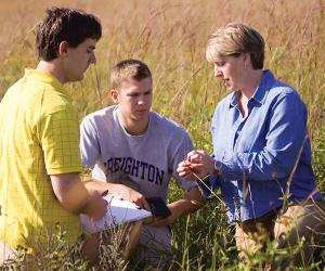 Students with environmental science professor Mary Ann Vinton