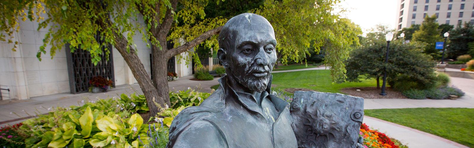 St. Ignatius statue outdoors on Creighton campus